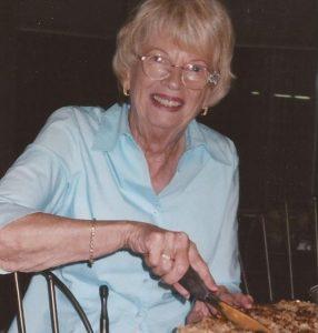 Mom cutting pie square
